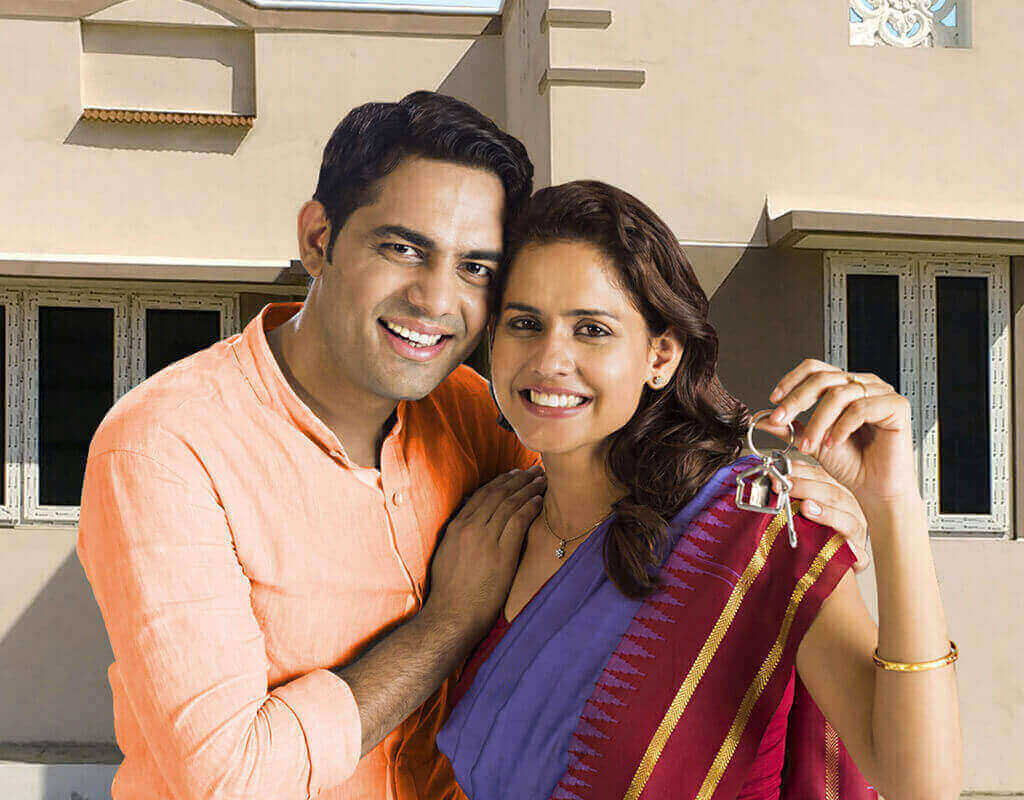 Happy Young Couple Holding Keys of New Home