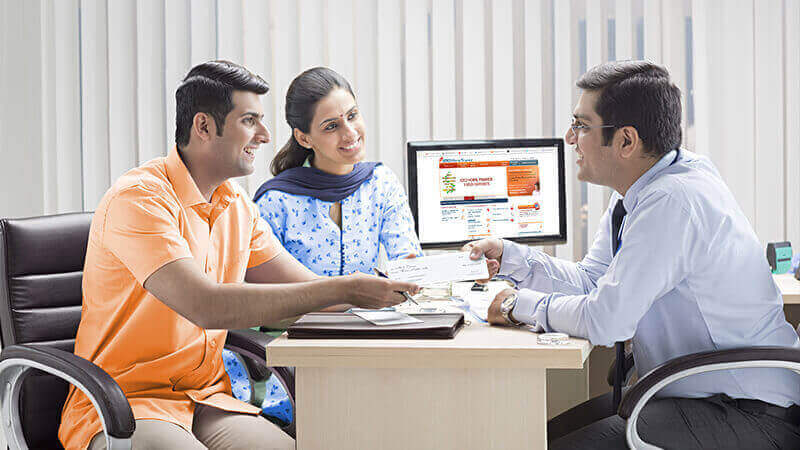 Couple Discussing About Home Loan With ICICI Home Finance Relationship Manager